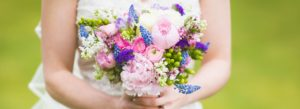 Detail of a bride holding her bouquet