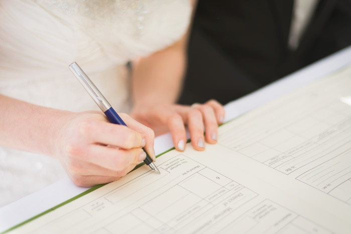Signing a wedding register at Stoke Rochford Hall