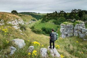 Landscape photographer James Abbott hiking in the Peak District