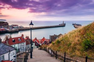 The view looking over Whitby West Pier and harbour at sunset from the 199 steps.