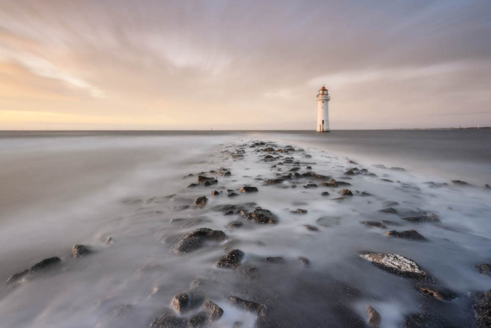 New Brighton Lighthouse at New Brighton Beach, Wallasey on the Wirral at sunset