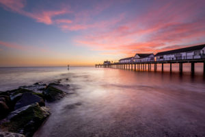 A colourful sunrise and long exposyre at Southwold Pier in Suffolk, UK.