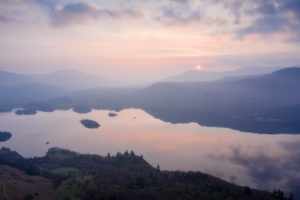 Overlooking Derwent Water from Cat Bells during a hazy sunrise and shot on the DJI Mavic 2 Pro
