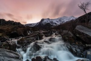 Cwm Idwal waterfall, in Snowdonia North Wales, at sunset in winter edited with the Orton effect