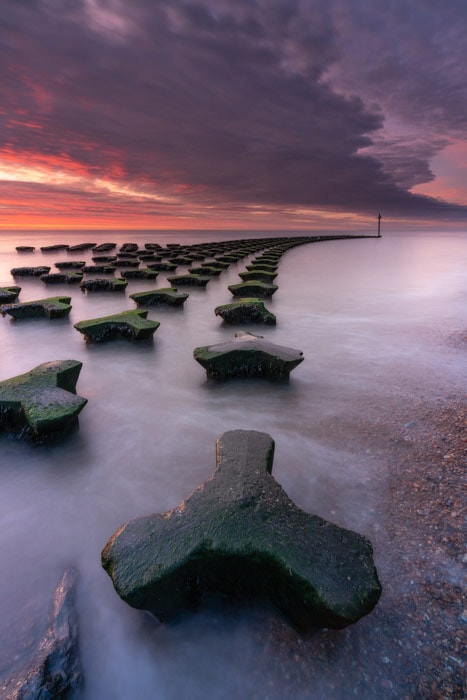 Long exposure of Cobbolds Point in Felixstowe at sunrise